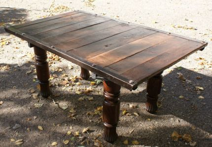 Vintage pallet used as a table top.  The legs are from a circa 1900 oak table.