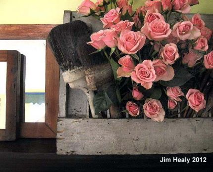 Here's a juxtaposition of an old industrial tool rack holding the splendor of blossoming roses.