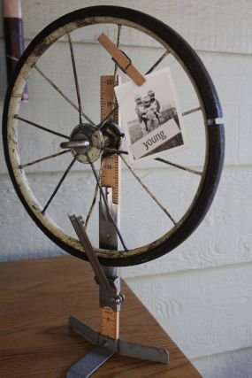 A vintage hem marker combined with an old wheel makes a great display piece...
