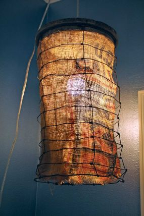 I got lucky and ran across this old wood top cage structure that I drilled a hole in the top of and assembled a pendant lamp.  My wife used an old burlap sack to line the interior of the cage structure for a nice accent in the room with a purpose (light!).