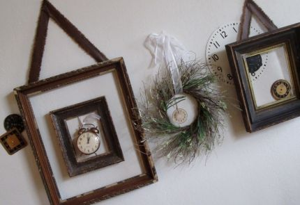 Framed clocks as wall art hung above my basement staircase.