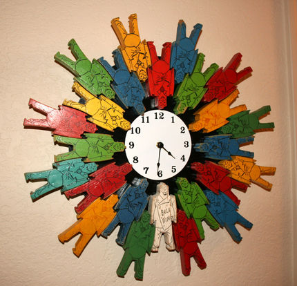 Bill Ding Clock  Vintage Bill Ding (get it??) man blocks. You're probably familiar with these guys – you stack them on top of one another and make wonderful buildings, sculptures, etc. I used my stash of really old and loved guys and built a clock facing. For the back structure, I used an old piece of teak wood off of a Lazy Susan and attached the clock mechanism to it. It measures about 1.5 feet across. You can find these happy little guys on eBay (new and used) or Google Bill Ding and find other resources.   I think this one is going to our pals Heather and Barry for their new little boy's room.