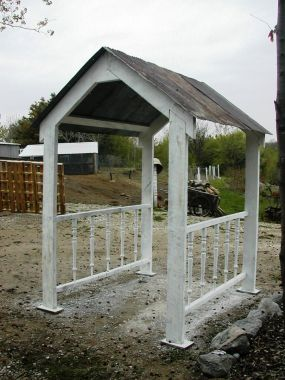 Garden Gazebo made with salvaged barn tin, barn timbers and spindles.