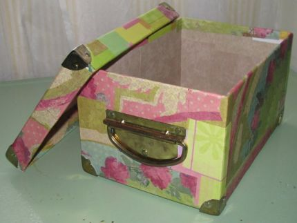 This was a good sturdy old box, but I never liked the Easter design on it. I updated it with scrapbooking paper (outside) and wallpaper (inside).