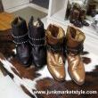Cowgirl boots and cowhides for your table top. Nice combination!
