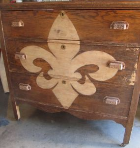 Someone had sorta tried to strip this dresser, but there was still a little paint here and there (see front leg) and 2nd drawer.  I loved that, so added a fleur de lis to add to the charm.