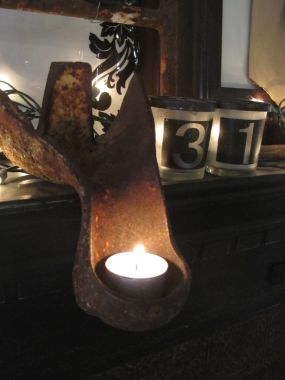I found that claw feet turned upside down worked great holding candlelight.