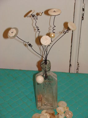 Heres a simple project - buttons and wire and a bottle!