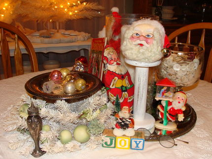 A gang of vintage Santas on my dining room table...