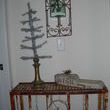 This is one of my favorite pieces.  It was a plant stand from a front step.  Glass was already added to the top when i purchased it.  I added an additional grate  to the top.  The tree is sitting in a lamp base.  The corbel I simply added the stencil, key and then waxed it.