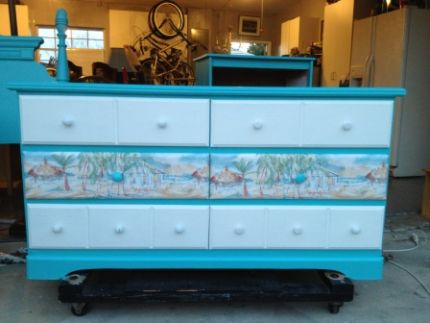 This was sanded, painted and drawers were wallpapered with a nautical border.