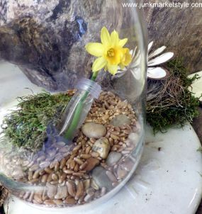A little vintage blue jar, a water tube, a fresh picked Crocus, wheat grass seeds, moss, and some pebbles. A little goes a long way!