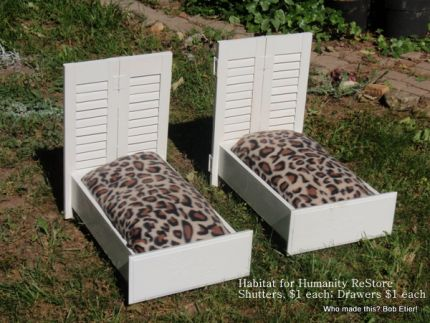Two drawers and two pairs of shutters, $4 at Habitat for Humanity Restore, Asheville, NC. The mattresses were pillows we had, and the leopard covers were made from one $2.88 fleece WalMart throw we repurposed from another project. Theres always white paint on hand.