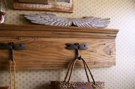 Flipped upside down, a salvaged piece of baseboard turns into a coat rack with the addition of decorative hooks.