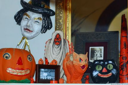 Here you see a mix of old and new on my fireplace.  The witch is a new piece as are the tiny pumpkins made from nuts.  The rest is vintage.