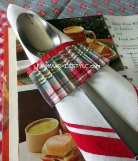 Vintage picnic napkins wrapped with an unusual napkin ring. Do you know what it is?