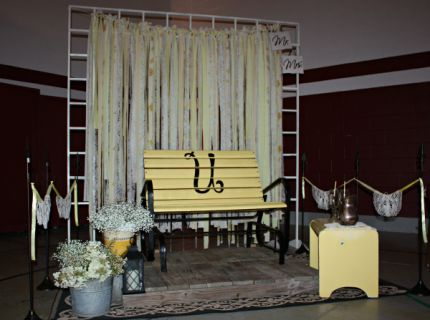 Perched atop a planked platform, this glider gave the bride and groom a cozy corner to enjoy the reception festivities.