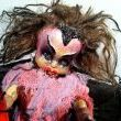 I love old worn out dolls..and giving them a new life, even if its a creepy one.