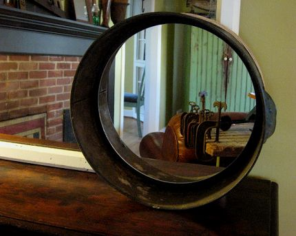 An inexpensive mirror was affixed to the interior of the pan using a hot glue gun.