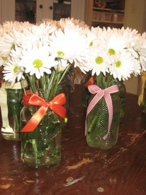 What says Texas wedding like mason jars and daisies? Simple and sweet! These were for the tables outside for the luncheon which were covered in vintage tablecloths over white long round ones. I have amassed a bunch of wrought iron furniture that we used with some rented to fill in.