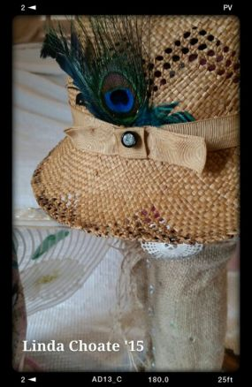 Just added some feathers and a vintage diamond glass button to jazz this hat up a bit.