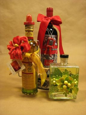 Bottled gifts are big during the holidays. Some contain bath bubbles, others cooking oils, and of course the ever favorite... bottled grapes.  Bottles tend to be pretty so dont put them in a bag. Instead, try enhancing their natural beauty.
