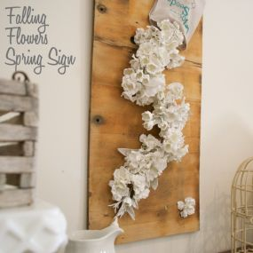 Then hot glue adds the seed packet and paint dipped flowers to an old board.