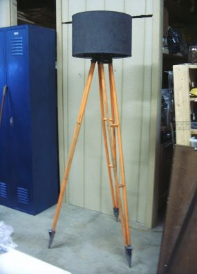 Made from a surveyors stand, this one is quite tall and would work well in an industrial, loft-type space.