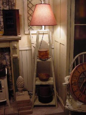 I LOVE MAKING LAMPS OUT OF DIFFERENT OBJECTS; THIS SHELF WAS BEGGING TO BE A LAMP. ONE DAY I DIDNT HAVE ENOUGH HANDS & SET A LAMPSHADE ON THE TOP SHELF, LOOKED AT IT & THE REST IS HISTORY :)