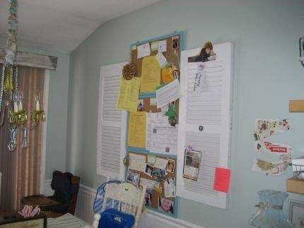 This is 3 bulletin boards(one for each boy)hanging in our kitchen. It is for their school notices and awards. I put a shutter on each side to help it to look like a window. We put notices/invites in the slats of the shutters with vintage clips to keep us organized.