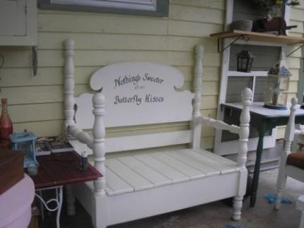 Nothings sweeter than Butterfly Kisses Bench This bench is the one I made for my granddaughter, it is her favorite. It is made from a Headboard and footboard of a twin bed. I like it so much better as a bench. It sets on my front porch, and we watch the butterflies on the lilac bush. This bench seat was made from a recycled waterbed headboard... all the tongue and groove pieces were taken from the back of the headboard, and the apron was cut down from one of the side pieces. It has a storage under the seat for shoes.