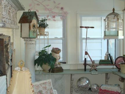 Cant have a garden room without a birdhouse or two...and dont you love the old pink scooter - now its a bookshelf!  And the pretty little lady on the left - we call her Rosie - she was a lamp base.