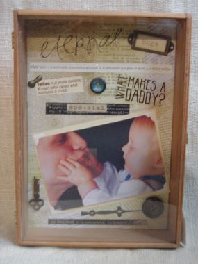 This is a cigar box frame.  I backed it with paper and used all different sticker, rub ons, and trinkets.  Its all about daddy.