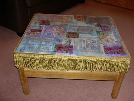Here is my table of faith, so called because I decoupaged it with pics of anything people might believe in, including love!!  I then added a gold fringe all the way round.