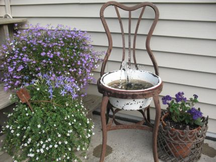 I dont have a before of this rusty old parlor chair, but it looked BAD!  When I hauled it home, my husband thought I was completely nuts.  I knew once it was bent back into shape though, it would look perfect on our patio!
