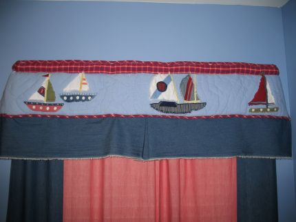 I cut the crib bumper in half, pulled out the padding and added fabric for more length to create the valance.