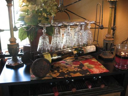 New wine caddie right at home on our dining room buffet.  This just goes to show that with a little imagination, a bit of luck, a good cleaning and a spray of poly,  something junky can be really cool and funky!