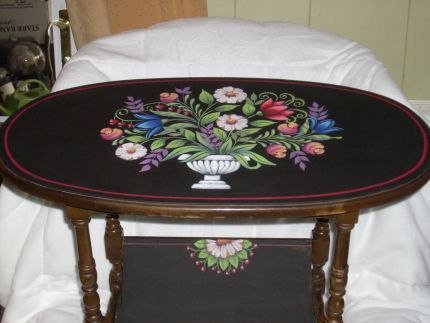 I painted on a little oval antique book table.