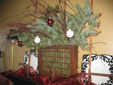 This rusty wall grate held live greens, branches and a few ornaments this past holiday season highlighting my dining room fireplace