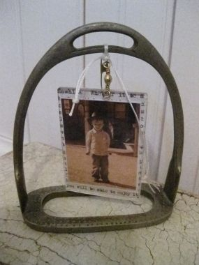 A cute little cowpoke framed up in a stirrup. What could be more adorable?!