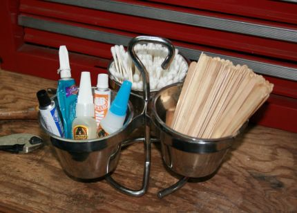 I found this little condiment twirly thing at the salvage yard in a bunch of restaurant equipment and found the perfect use for it! I have my glue tube selection, cotton swabs and Popsicle sticks always at the ready. Easy stuff but oh, so helpful.