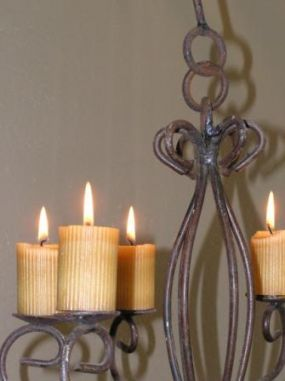 A rusty chandelier and some votives equals a sweet sight in my kitchen.