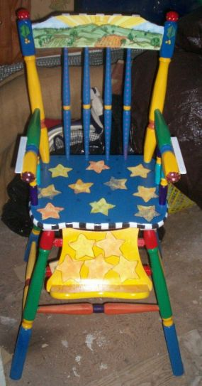 This old wooden high chair had seen better days...After sanding it too, and painting it in colors I think any child would love, it has been reborn!