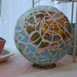 Heres a mosaic bowling ball - a scene from a broken teapot is the center, and the base of the teapot is now the base of the piece.