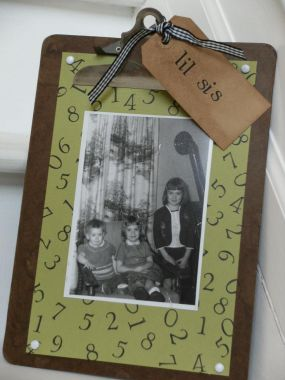 Using an old clipboard as the frame, I stamped cardstock with numbers and attached my sisters photo.  New inexpensive clipboards can be purchased at many dollar-type and discount stores.