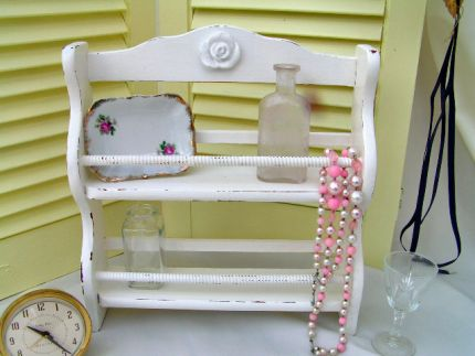Just a vintage spice rack - now a cute Chic knick-knack Shelf. Painted crisp cottage white.